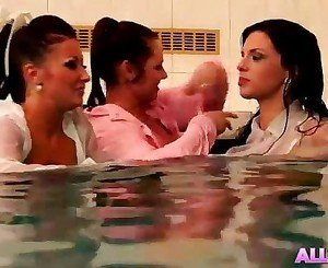 Three Hot Lesbians Playing In A Pool