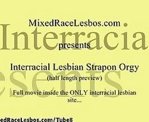 Interracial Lesbians in Strapon Orgy
